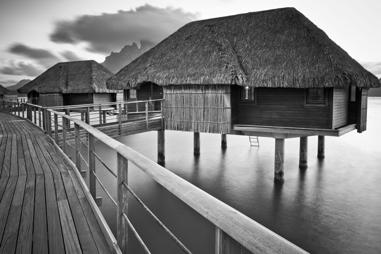 Four Seasons Bora Bora Resort overwater bungalow in black-and-white