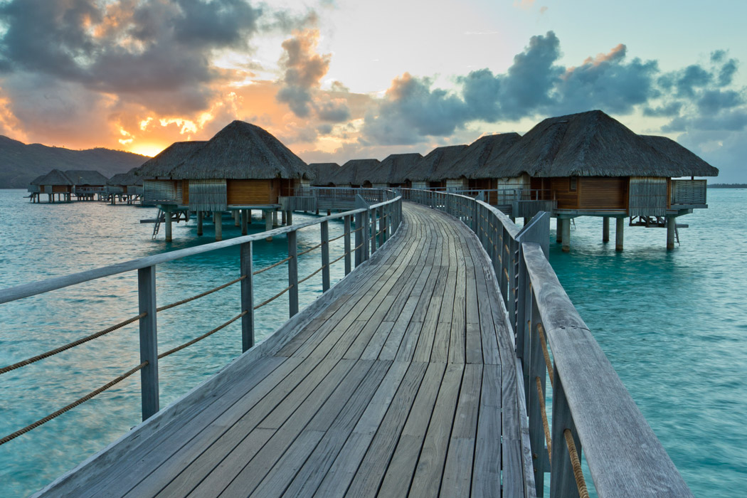Orange sunset behind the Bora Bora Four Seasons Resort