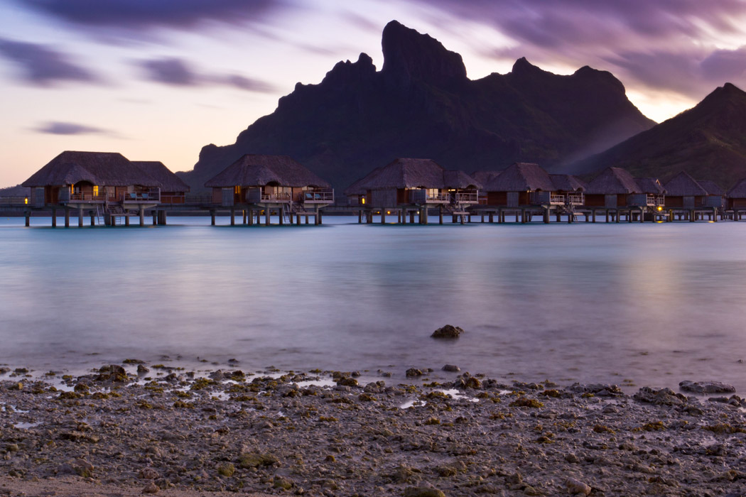 Purple sunset behind Mount Otemanu and overwater bungalows