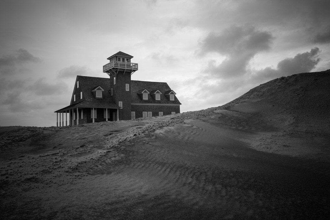 Oregon Inlet Life-saving Station behind a sand dune of the Pea Island National Wildlife Refuge