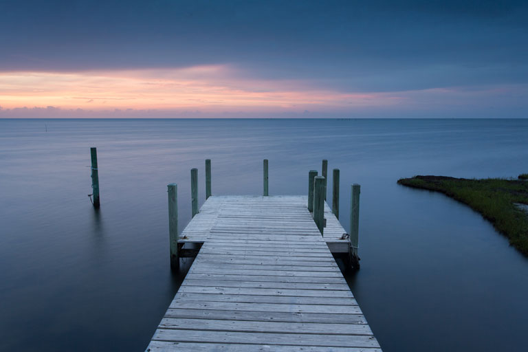 Sunset from a dock on the Pamlico Sound of the Outer Banks, North Carolina